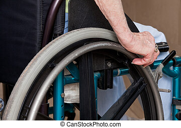 Woman's Hands on Wheelchair