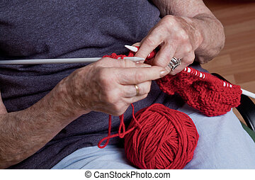 Senior Woman Knitting - Portrait of a senior woman knitting.