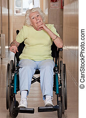 Retired Woman on Wheelchair - Retired woman on wheelchair at...