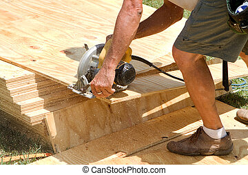 Carpenter Power Saw - Sawdust fills the air as a carpenter...