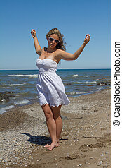 Women Dancing on the Beach - Happy Women on The beach in...