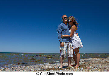 Women and Man relaxing on the Beach - Young couple man and...