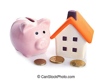 coin bank and house - conceptual image with piggy bank, coin...