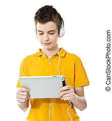 Boy listening to music on tablet pc