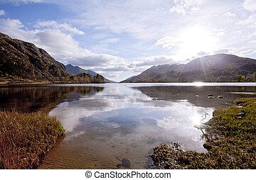 Loch Shiel Lake at Glenn Finnan Highlands Scotland - Sun...