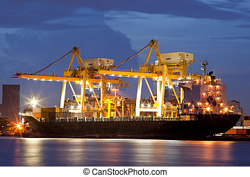 Cargo Ships at dusk - Container Cargo freight ship with...