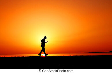 jogger in sunset near a beach