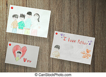 Drawing of family, paper on wood background