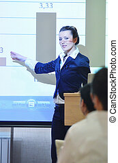 business woman giving presentation - business people group...