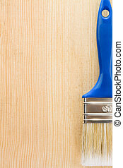 paintbrush on wood background texture