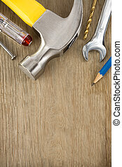 construction tools on wood background - construction tools...