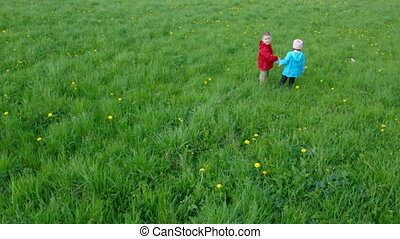 boy and small girl  on meadow