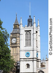 St Margaret Church tower and Big Ben in London, UK