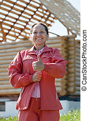 Happy  woman against  building residence