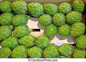 artichokes - many artichokes for sale on the market over...