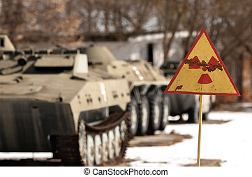 Radiation hazard sign with tanks