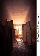 Doorway with bright light in an abandoned building