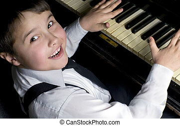 Little boy and piano