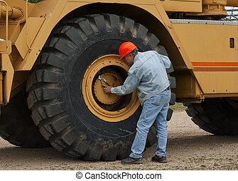 heavy industry mechanic - male worker doing maintenance on a...