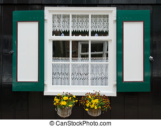 Window with shutters in Marken