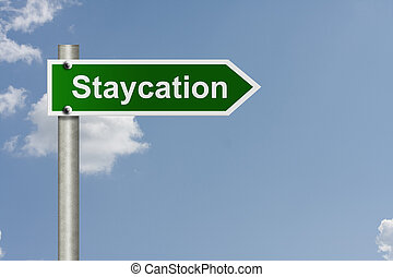 Taking a staycation - An American road sign with sky...