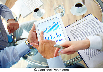 Financial fluctuations - Business work-group analyzing...