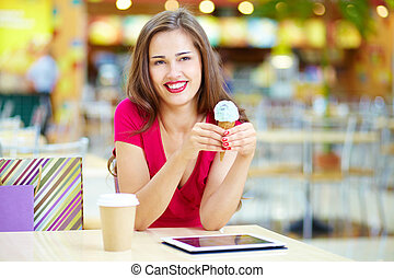 Modern tech and ice-cream - Young woman having a rest after...
