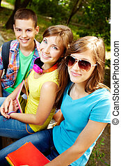 Smiling teens - Vertical shot of three teens smiling...