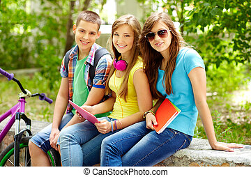 After school - Cheerful teens spending time together after...