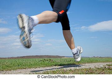 Runner - Outdoor closeup shot of a male runner running at a...