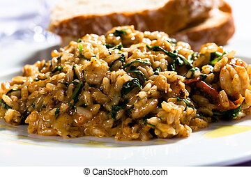 Risotto with spinach and bacon served with white bread.