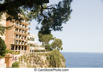 luxury apartment condos built on rocky cliff over Mediterranean Sea Monte Carlo Monaco