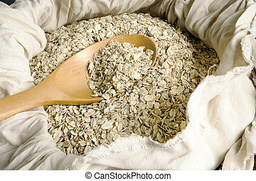 Rolled oats seed - Dry rolled oats seed in wooden spoon