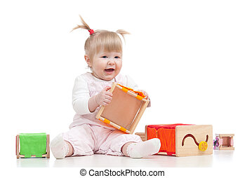 smiling baby girl playing with color educational toy