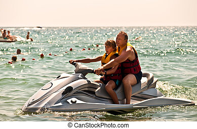 Father and son on a water bike .