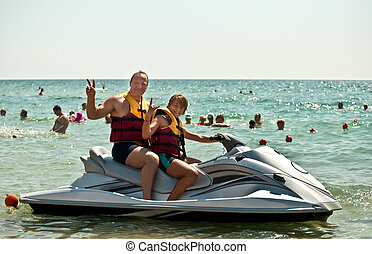 Father and son on a water bike . - Happy family on the water...