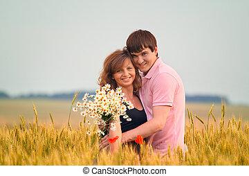 loving couple in a field