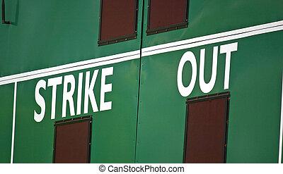 Scoreboard - A cropped scoreboard in the outfield of a...