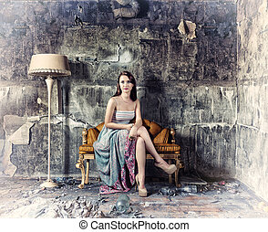 women in grunge interior - young beautiful women, sitting in...