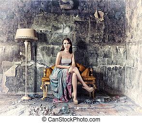 women in grunge interior - young beautiful women, sitting in...