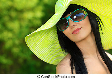green hat - Portrait of a beautiful young woman in...