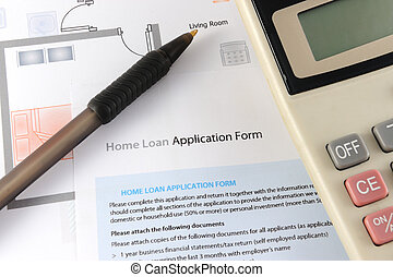 Home loan application form with calculator and pen nearby
