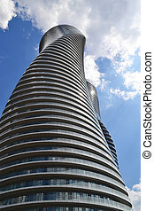 Two twisted towers. - The look up of two twisted round high...