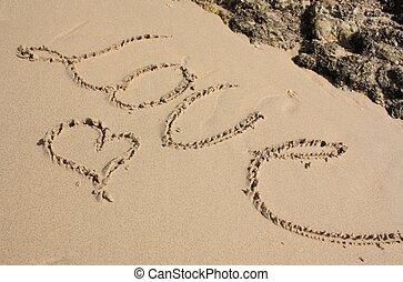 Word LOVE on the beach