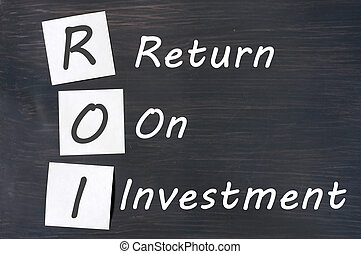 ROI acronym for Return on Investment written with chalk on a...