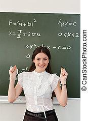 teacher rejoices success - The teacher in the classroom on...