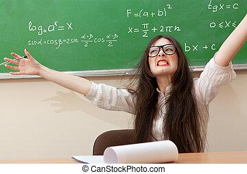 angry teacher - The teacher in the classroom on blackboard...