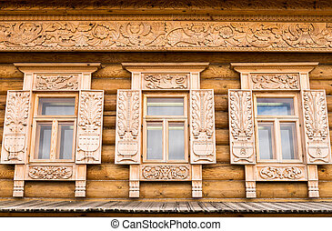 Wooden decorated windows in log house, Russian traditional...