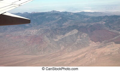 Flying (5X) above mountain desert