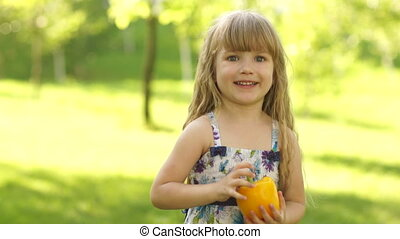 Girl with a vegetable in the hands - Children and food...